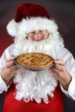 Papá Noel y empanada cocida fresca Foto de archivo