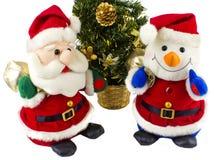 Papá Noel y hombre de la nieve Foto de archivo libre de regalías