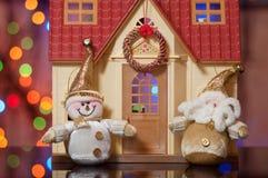 Papá Noel y muñeco de nieve Fotografía de archivo