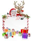 Papá Noel y muestra del reno Imagen de archivo