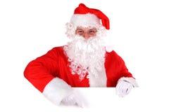 Papá Noel y muestra en blanco Imagenes de archivo