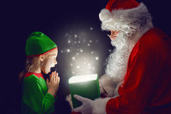 Papá Noel y niña fotografía de archivo