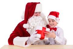 Papá Noel y niño Foto de archivo libre de regalías