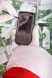 Papá Noel y palmtop personal del bolsillo. fotos de archivo libres de regalías