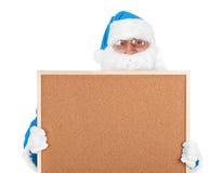Papá Noel y parte azules del tablón de anuncios vacío Foto de archivo libre de regalías