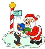 Papá Noel y pingüino perdido Imágenes de archivo libres de regalías