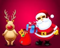 Papá Noel y regalos de la Navidad con los ciervos de la lluvia Imágenes de archivo libres de regalías