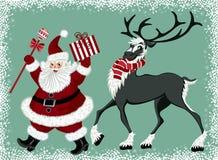 Papá Noel y reno Foto de archivo libre de regalías