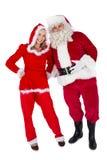 Papá Noel y señora Claus que sonríe en la cámara Imágenes de archivo libres de regalías