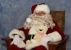 Papá Noel y un oso de peluche fotos de archivo libres de regalías
