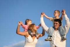 Papá y mama con los niños Foto de archivo libre de regalías