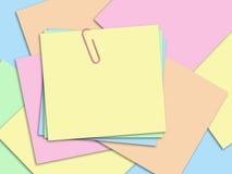 Papéis da cor com um grampo Imagens de Stock