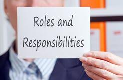 Papéis e responsabilidades imagem de stock