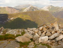 Pap of Glencoe View. View from Pap of Glencoe (Sgurr na Ciche) with small cairn with memorial plaque in foreground and other mountains behind including the Royalty Free Stock Photo