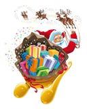 Papá Noel con el regalo. Imagen de archivo