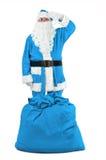 Papá Noel divertido en saludos azules del traje Imagenes de archivo