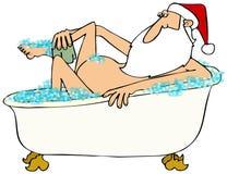Papá Noel que toma un baño de burbujas Imagenes de archivo