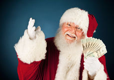 Papá Noel: Santa Holding Fanned Out Cash Foto de archivo