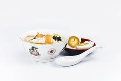 Papa de aveia do arroz dos peixes com ovo salgado Imagens de Stock