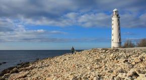 Papa et fille près du phare Photos stock