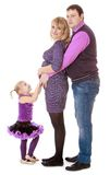 Papa et petite fille frottant le ventre à lui Photographie stock libre de droits