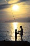 Papa et professeur de pêche Images libres de droits