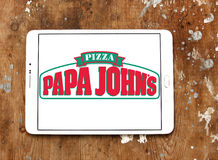 Papa johns pizza logo. Logo of papa johns pizza restaurant on samsung tablet on wooden background Stock Photos