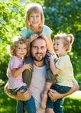 Papa met jonge geitjes Stock Foto