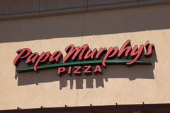 Papa Murphy's Pizza Fast Food Restaurant. International franchise chain pizza food Papa Murphy's restaurant sign. Papa Murphy's has a menu of take-n-bake Royalty Free Stock Image