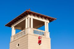Papa Noel climbing up the wall. Palma, Majorca, Spain. Santa Claus Papa Noel climbing up the wall. Palma, Majorca, Spain Royalty Free Stock Photo
