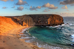 Papagayo Beach, Canaries, Spain. Landscape with the famous Papagayo Beach on the Lanzarote Island in the Canary Islands Archipelago, Spain at sunset time Stock Images