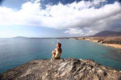 Papagayo beach with transperent water. woman sit on hill, relax Stock Image