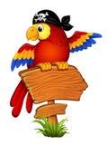 Papagei auf einem hölzernen Zeiger Stockbilder