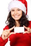 Papai Noel bonito que prende o cartão em branco Foto de Stock Royalty Free
