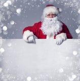 Papai Noel com bandeira Fotografia de Stock Royalty Free