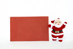 Papai Noel com cartão vermelho Imagens de Stock