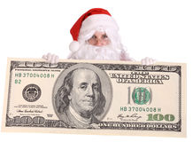 Papai Noel com a nota de banco grande do dólar. Fotos de Stock