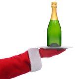 Papai Noel com o frasco de Champagne na bandeja Fotografia de Stock Royalty Free
