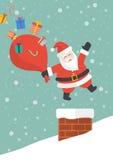 Papai Noel com o saco grande vermelho que salta na chaminé Fotografia de Stock