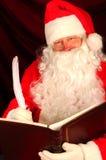 Papai Noel com a pena do livro e de Quill Fotografia de Stock Royalty Free