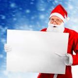 Papai Noel com placa em branco Fotos de Stock Royalty Free