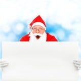 Papai Noel com placa em branco Foto de Stock