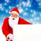 Papai Noel com placa em branco Fotografia de Stock