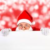 Papai Noel com placa em branco Fotografia de Stock Royalty Free