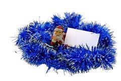 Papai Noel com um cartão no ouropel Fotografia de Stock