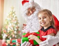 Papai Noel e menina Imagem de Stock