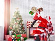 Papai Noel e menina Imagens de Stock