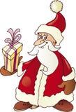 Papai Noel e presente Fotos de Stock