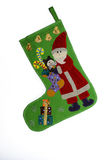 Papai Noel em sua bota Imagem de Stock
