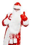 Papai Noel feliz no chapéu vermelho com dinheiro do dólar Imagens de Stock Royalty Free